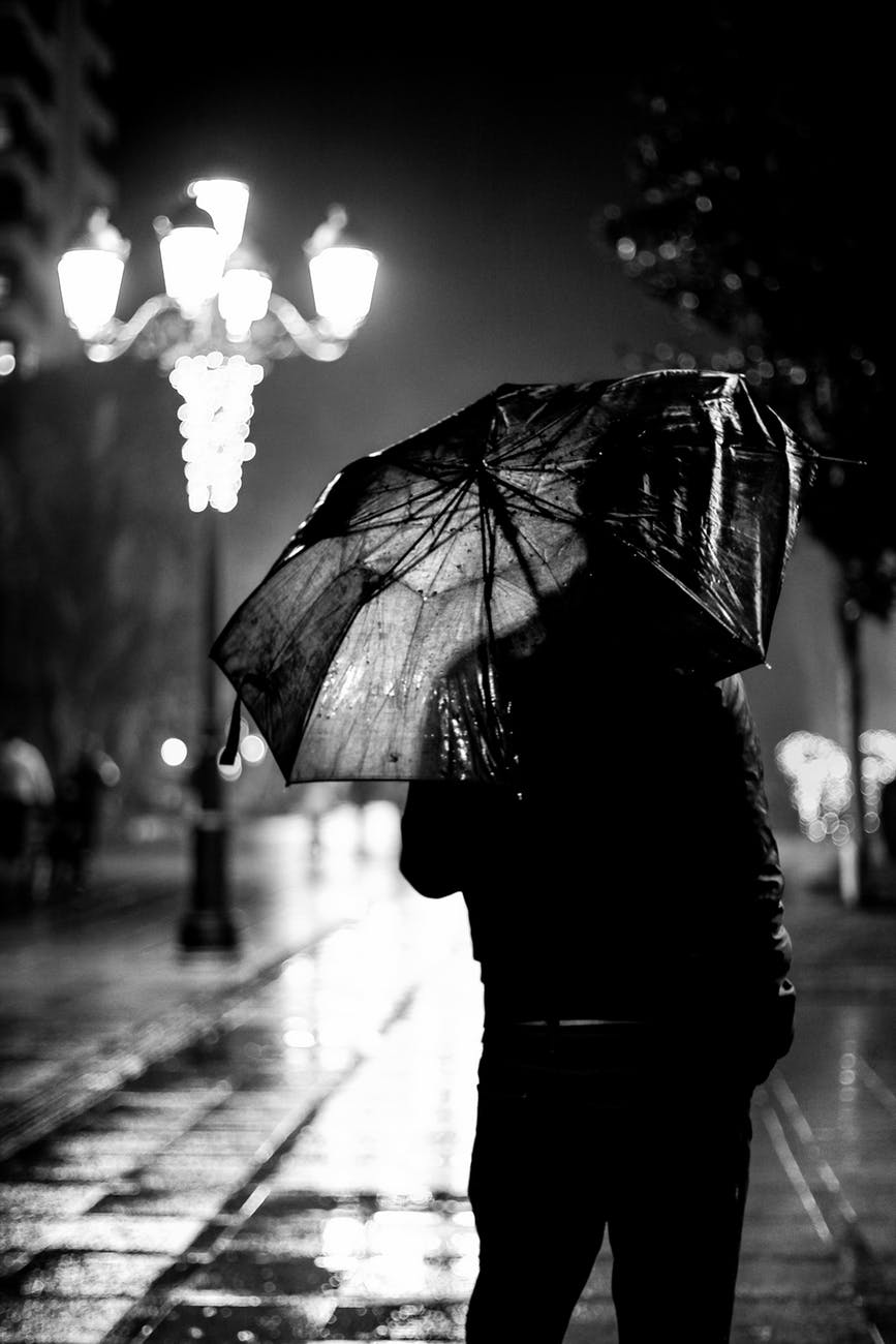 black and white man weather rainy